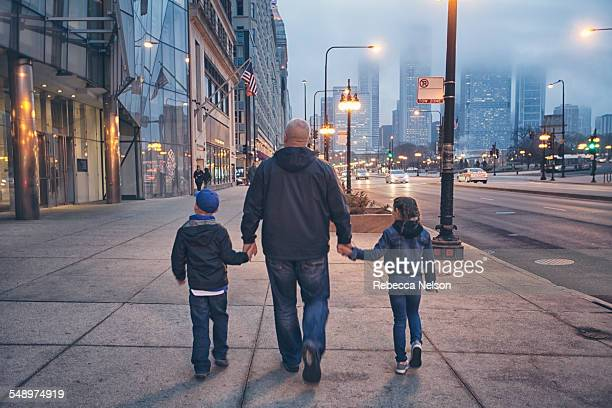 family walking down Michigan Avenue in Chicago