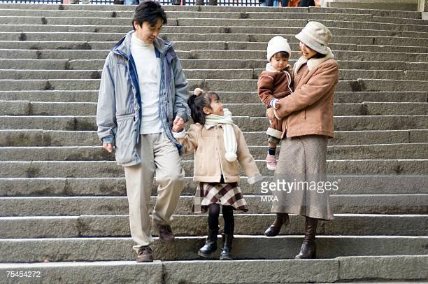 Family walking down stairs