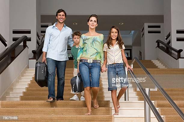 Family walking down stairway