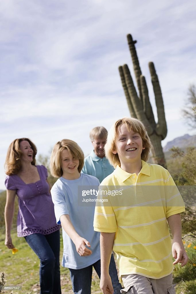Family walking in desert, Arizona : Stock Photo