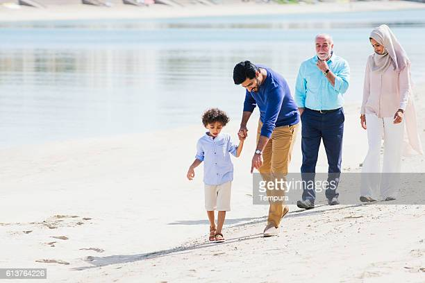 Family walking in Dubai and sharing and afternoon outdoors.