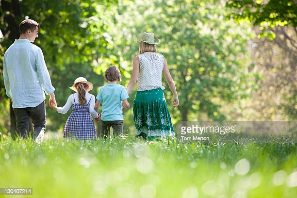 Family walking in field of flowers