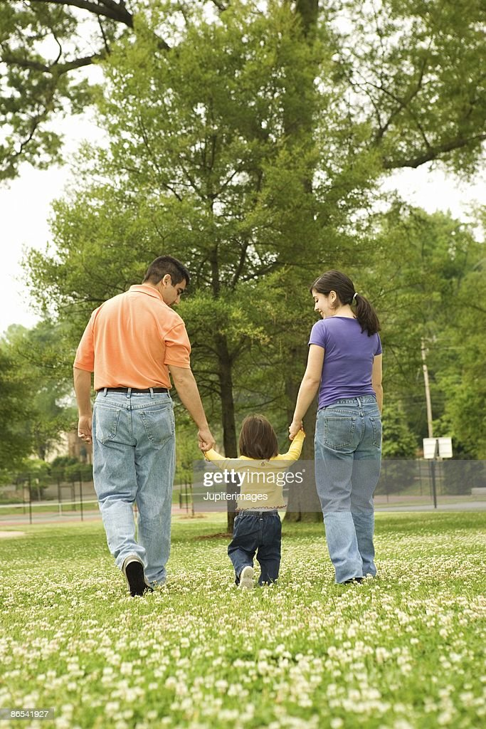 Family walking in park : Stock Photo