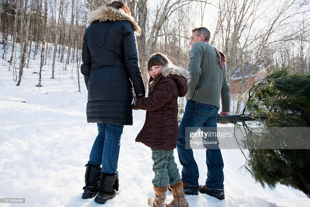 Family walking in snow : Stock Photo