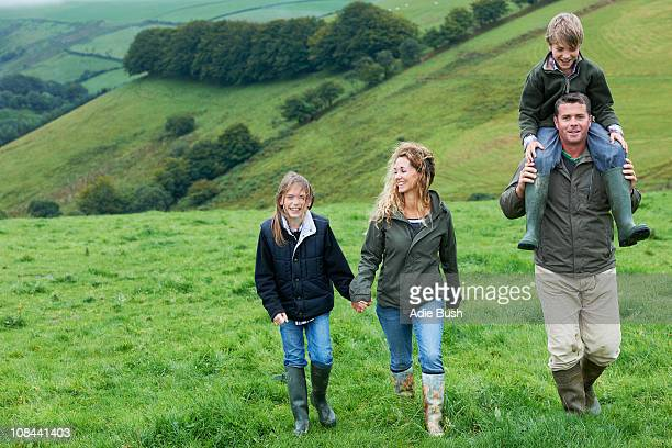 Family walking in the fields