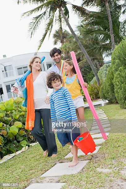 Family walking in the garden of a tourist resort