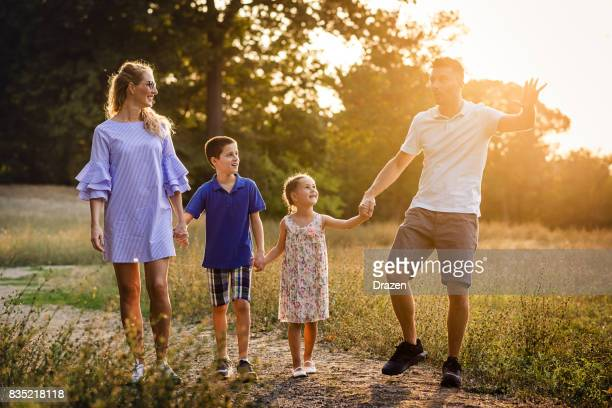 Family walking in the nature in early autumn