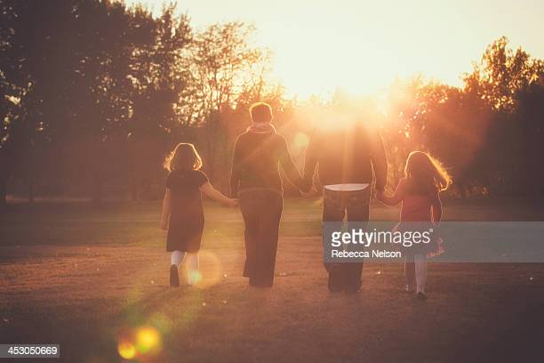 Family walking into the sunset