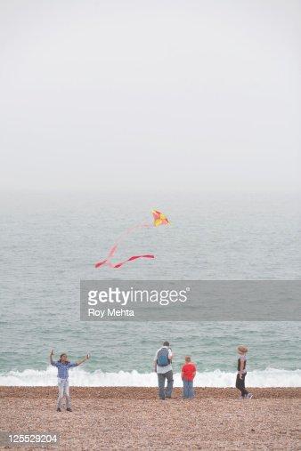 family walking on a beach : Stock Photo