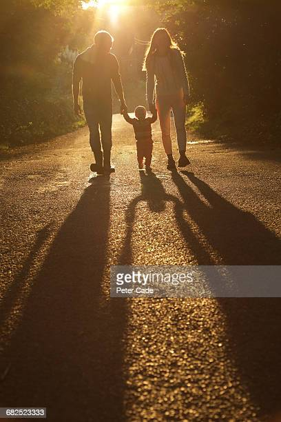 Family walking on country lane
