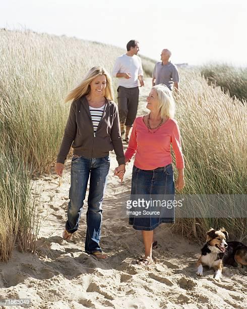 Family walking on dunes