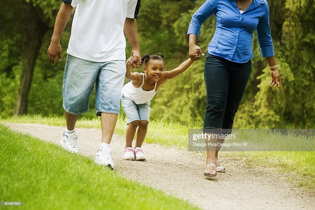 Family walking on pathway : Stock Photo
