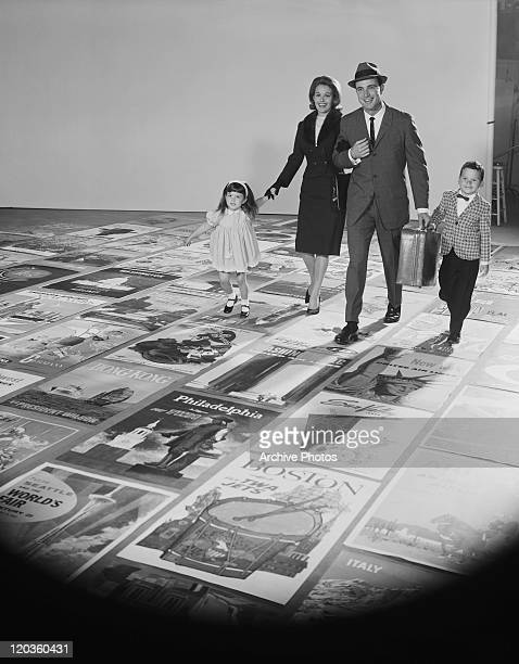 Family walking on poster of travel