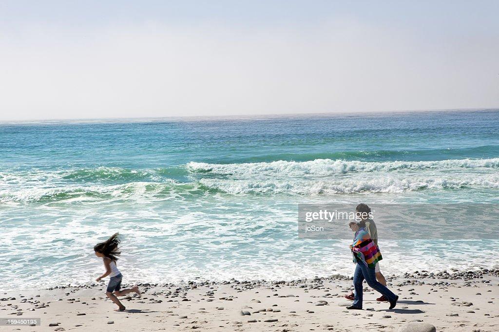 Family walking on the beach : Stock Photo