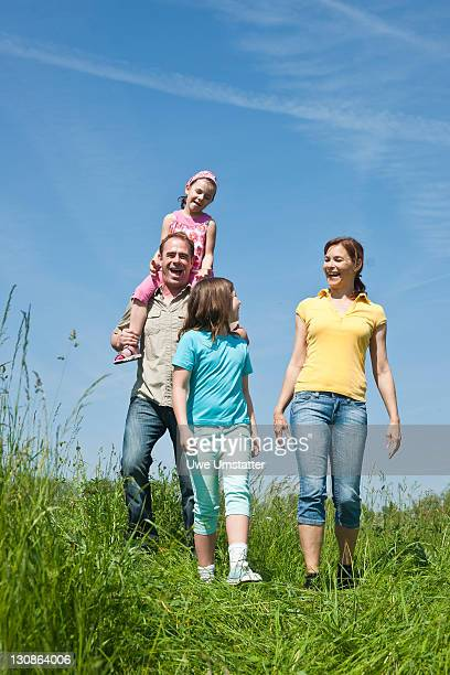 Family walking relaxed in a flower meadow