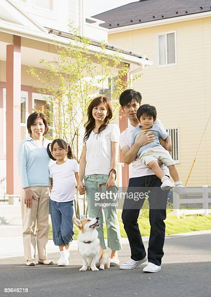 Family walking their dog