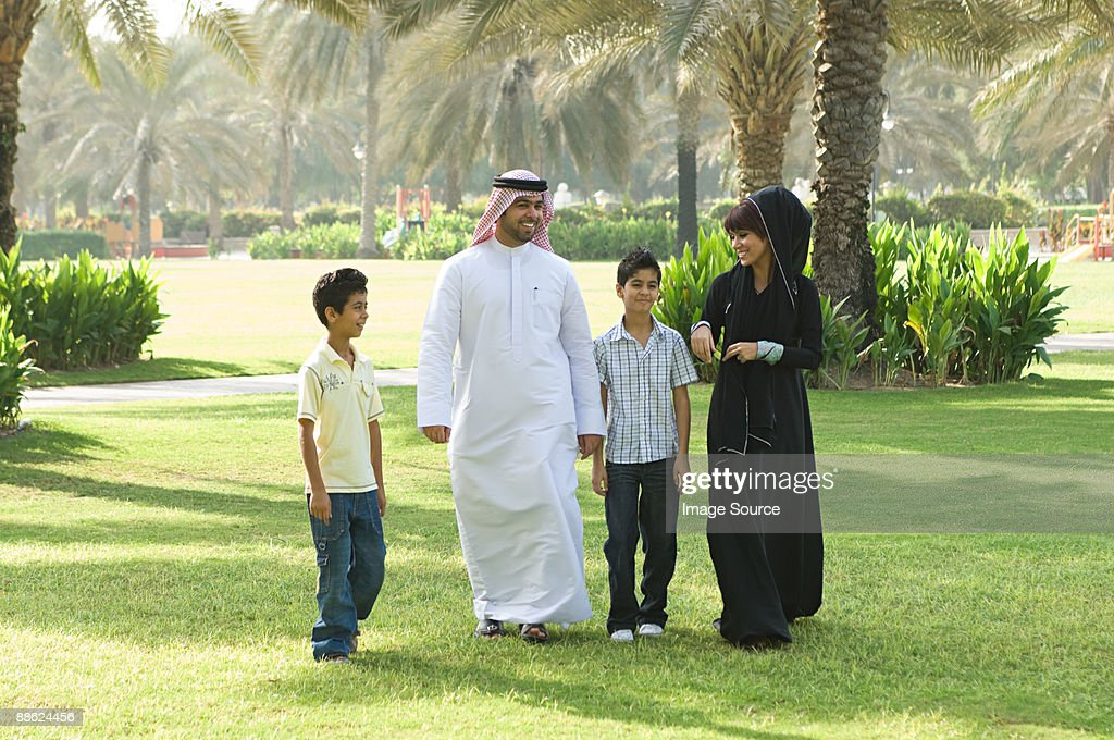 A family walking through a park