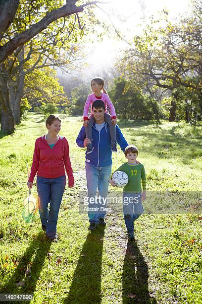 Family walking through a park together
