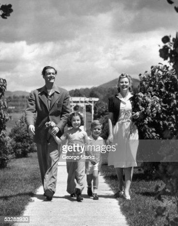 Family walking through park : Stock Photo