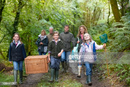 Family walking through the woods