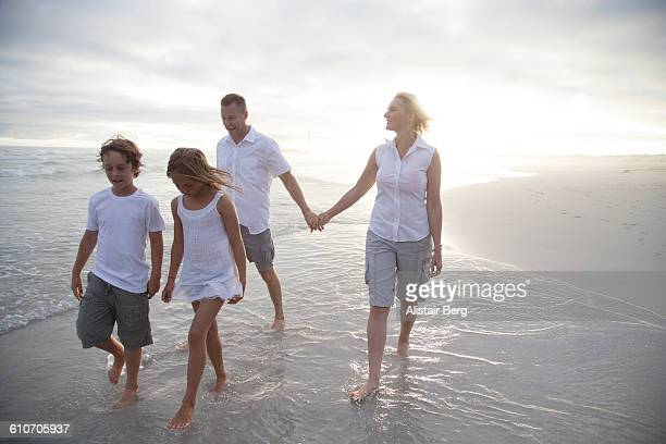 Family walking together along a beach