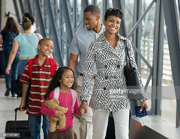 Family walking together in airport