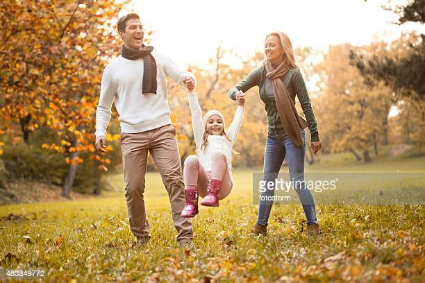 Family walking together in an autumn park