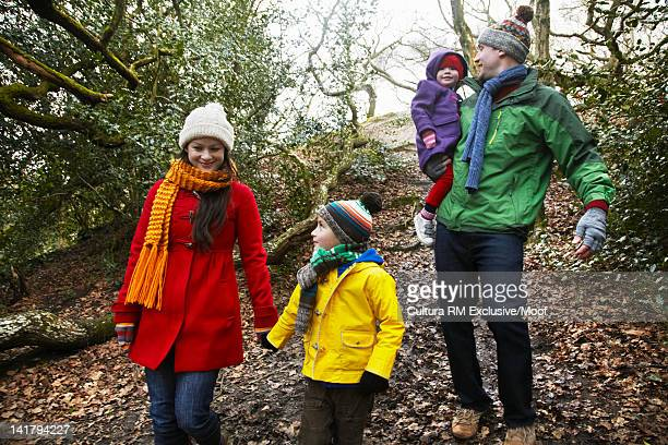 Family walking together in forest