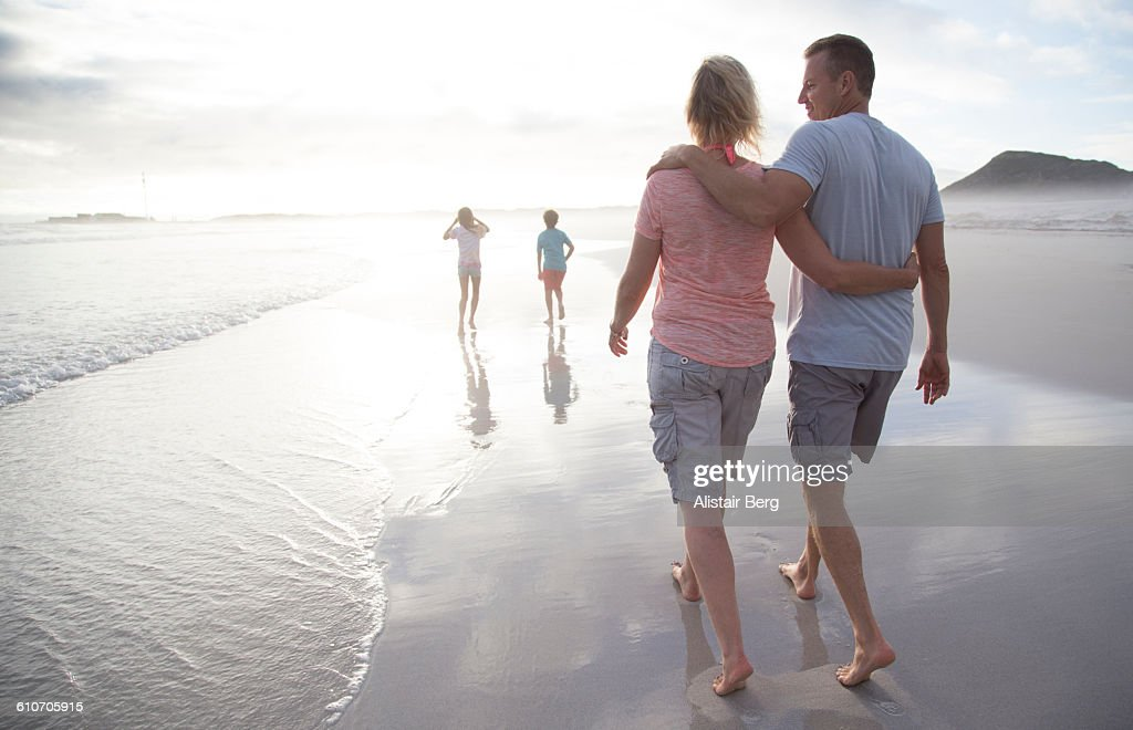 Family walking together on a beach