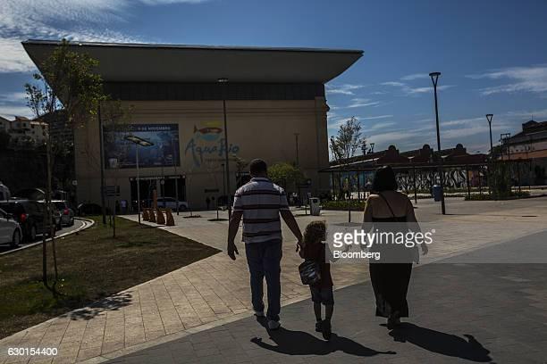 A family walks towards the Aquario South America's biggest aquarium in Rio de Janeiro Brazil Saturday Dec 3 2016 Home to some 8000 marine animals it...