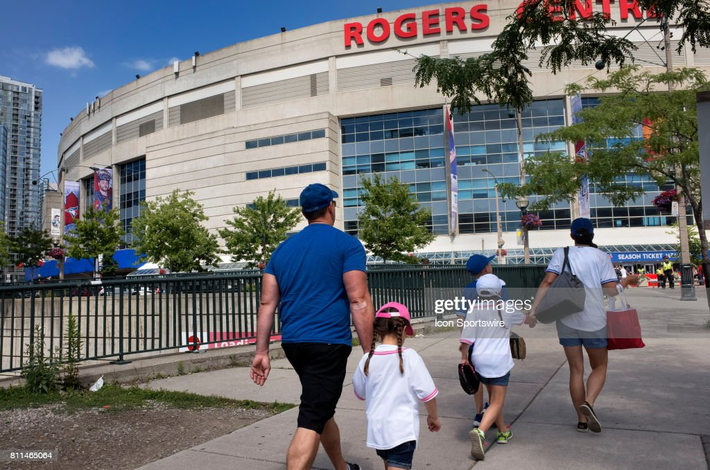 A family walks towns the stadium before the regular season MLB game between the Houston Astros and the Toronto Blue Jays on July 08, 2017 at Rogers Centre in Toronto, Ontario, Canada.