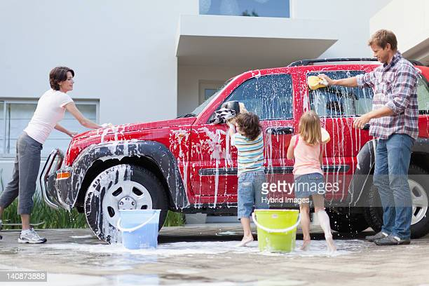 Family washing car together