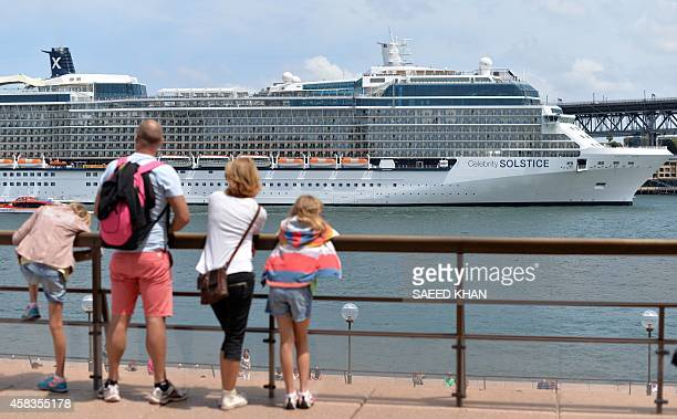 A family watch a giant cruise ship at Sydney Harbour on November 4 2014 Australian Prime Minister Tony Abbott on November 4 defended using coal to...