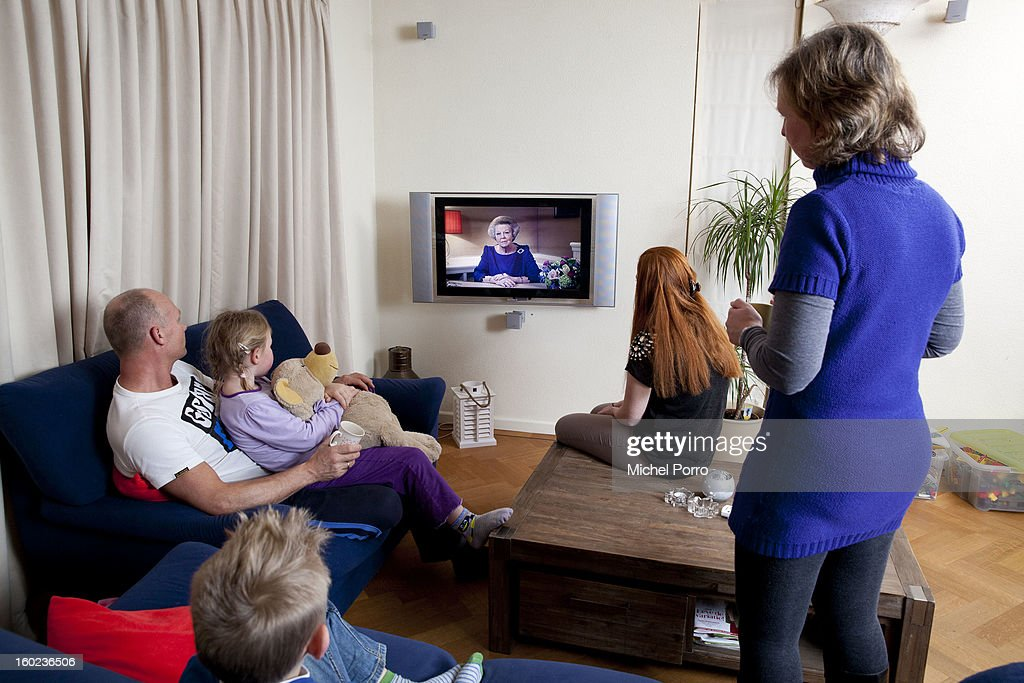 A family watches the television as Queen Beatrix of The Netherlands announces her abdication in favour of her son Prince Willem-Alexander on January 28, 2013 in Amsterdam, Netherlands.