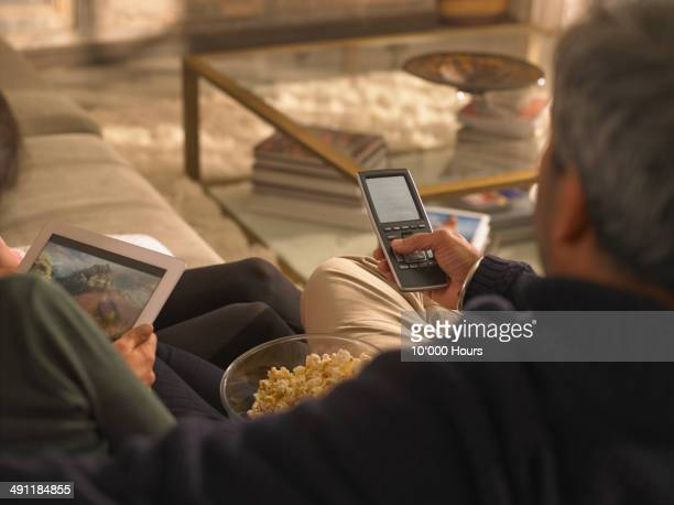 A family watching a film streamed from and iPad