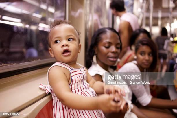 Family watching curious mixed race girl