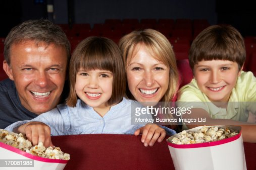 Family Watching Film In Cinema : Stock Photo