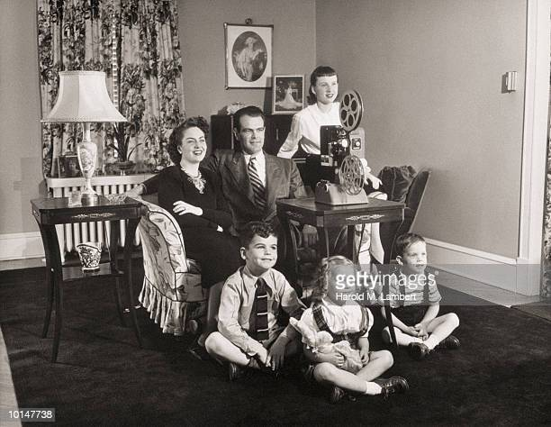 FAMILY WATCHING HOME MOVIES, 1946