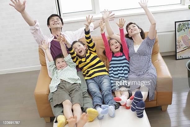 Family watching sports program