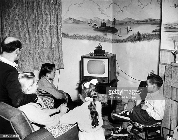 Family watching television 15 May 1957 The Lancaster family watching television at their home in Stamford Road Blacon near Chester Photograph by Ralph
