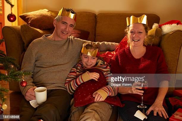 Family watching television at christmas