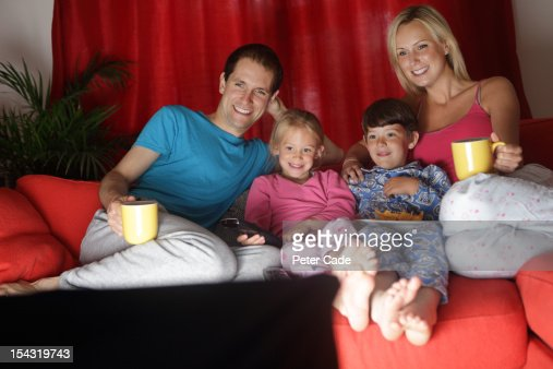 Family watching television before bed : Stock Photo