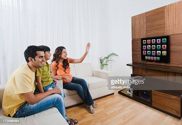 Family watching television in a living room