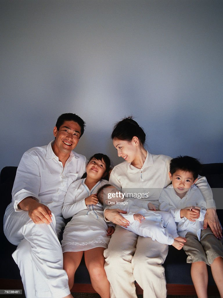 Family watching television program : Stock Photo