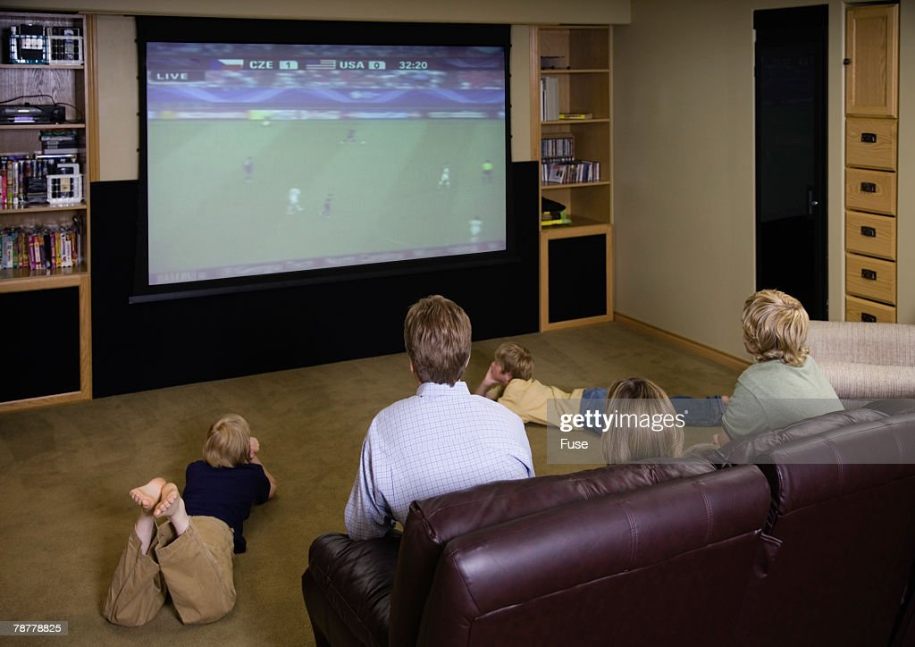 family watching television together stock photo getty images