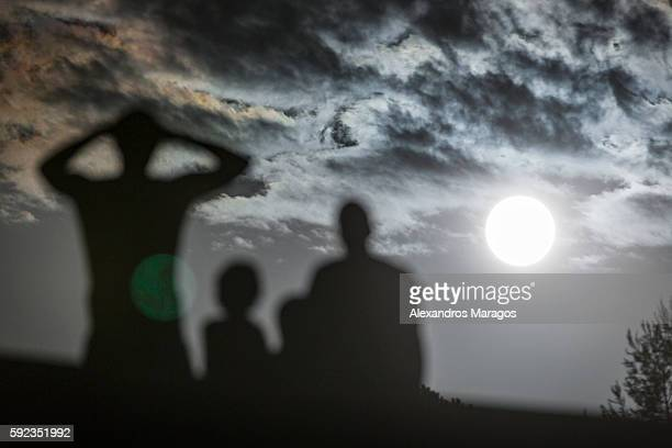 Family watching the Full Moon