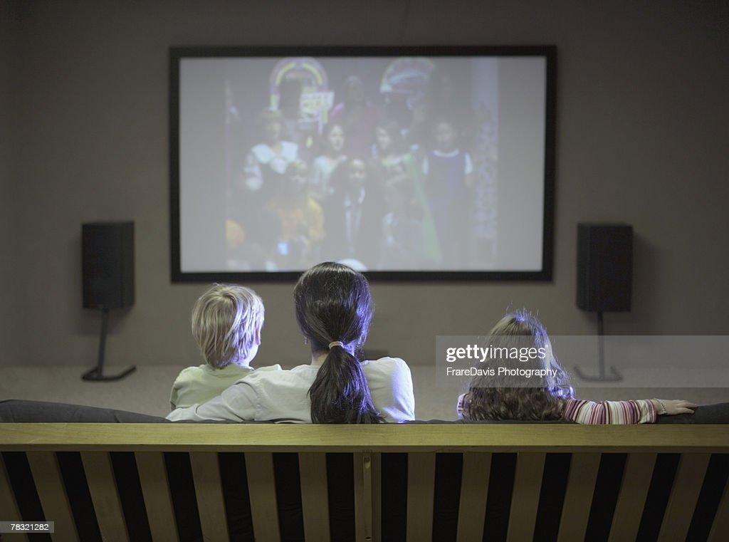 Family watching tv : Stock Photo