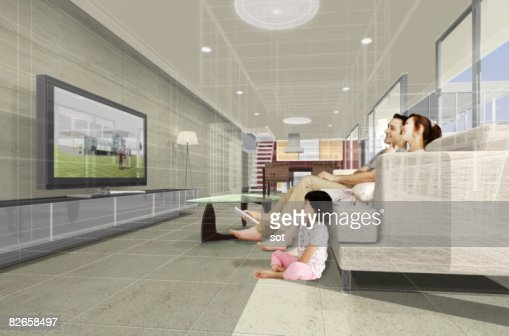 Family watching tv together, flat s : Stock Photo