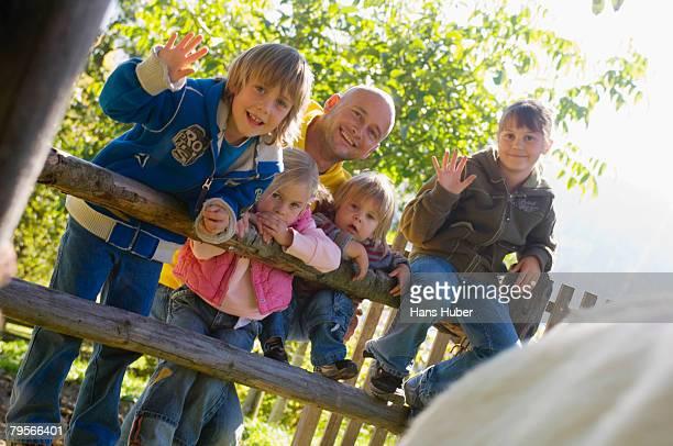 Family waving to camera