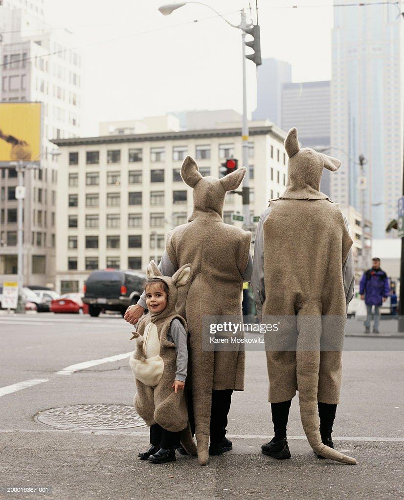 Family wearing kangaroo costumes, downtown Seattle, USA : Stock Photo